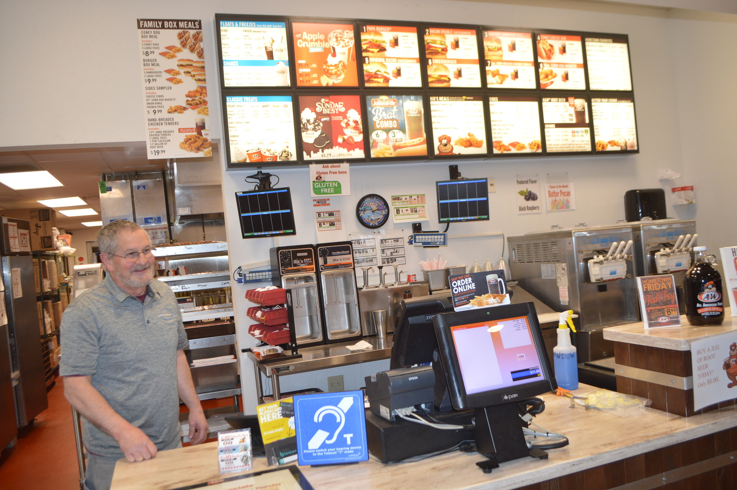 My Hearing Loop Senior Technician Tom Young works on the A & W counter top loop installation.